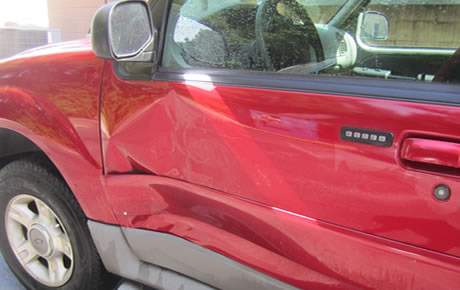 Drivers door took some damage  Dent removed and paint matched perfectly.